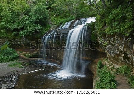 Cascade Falls waterfall in Osceola, Wisconsin USA. Royalty-Free Stock Photo #1916266031