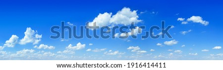 Cloudscape - Blue sky and white clouds, wide panorama Royalty-Free Stock Photo #1916414411