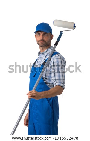 Portrait of male house painter with paint roller isolated on white background