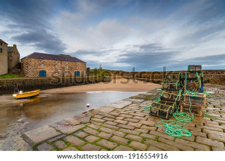 The quay at Portsoy a fishing harbour of Portsoy in Aberdeenshire in Scotland Royalty-Free Stock Photo #1916554916