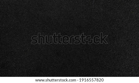 Panorama of Black rubber running track flooring texture and background seamless Royalty-Free Stock Photo #1916557820