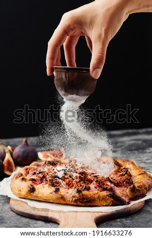 Sugar icing on fig galette