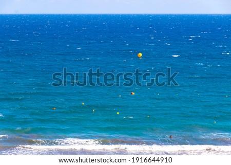 Azure color of Atlantic ocean on Maspalomas Beach (Playa de Maspalomas), Gran Canaria island, Canary Islands, Spain. One of the best beach in the Canaries Royalty-Free Stock Photo #1916644910