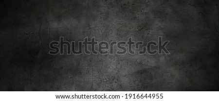 Texture of dark gray concrete wall, Texture of a grungy black concrete wall as background Royalty-Free Stock Photo #1916644955