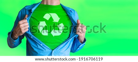 Man chest green superhero of recycling Recycling Symbol Isolated on green background. Protect and save Earth Planet
