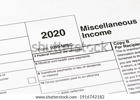 1099 miscellaneous income tax form. Concept of income taxes and federal tax information. Royalty-Free Stock Photo #1916742182