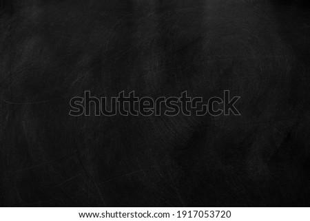 Texture of chalk on black chalkboard or blank blackboard background. School education, dark wall backdrop, template for learning board concept. Royalty-Free Stock Photo #1917053720