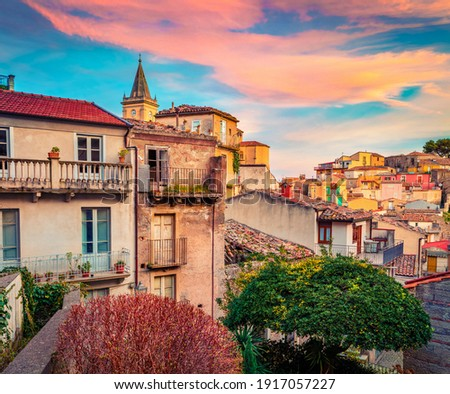 Сharm of the ancient cities of Europe. Wonderful cityscape of Novara di Sicilia town. Colorful spring sunrise in Sicily, Italy, Europe. Beautiful world of Mediterranean countries.  Royalty-Free Stock Photo #1917057227