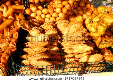 Pictures of fried curry puffs. Evening snack of many Malaysians.