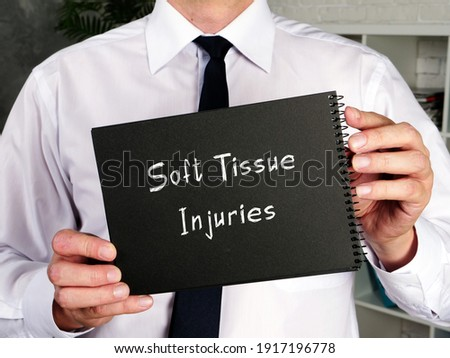 Soft Tissue Injuries inscription on the piece of paper. Royalty-Free Stock Photo #1917196778