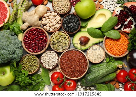 Different vegetables, seeds and fruits on grey table, flat lay. Healthy diet Royalty-Free Stock Photo #1917215645