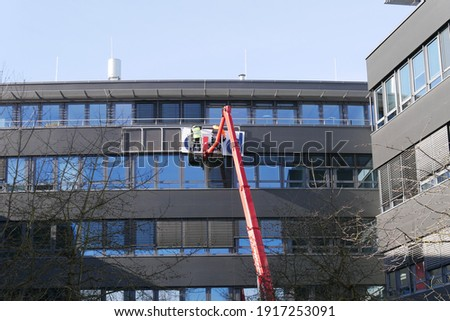 Germany's biggest historical fraud case Wirecard comes to an end with the dismantling of the logo and advertising signs. Former German DAX 30 flagship company reaches the end and logo is dismantled. Royalty-Free Stock Photo #1917253091