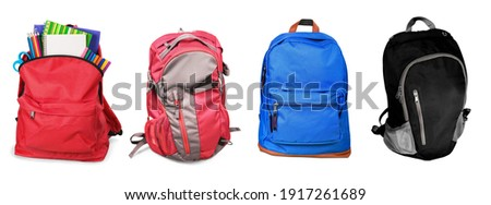 Set of colored backpacks with bright school stationery Royalty-Free Stock Photo #1917261689