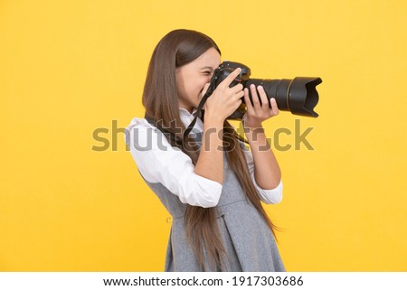 professional. happy child photographing. school of photography. hobby or career. photographer beginner with modern camera. making video. childhood. teen girl taking photo. kid use digital camera.