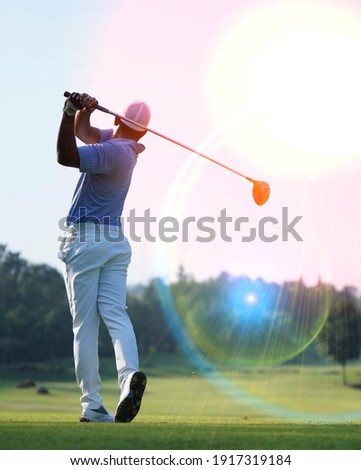 Golfers are playing golf at field selective focus background  Royalty-Free Stock Photo #1917319184