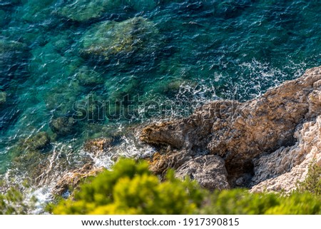 Shot of a shoreline rocks along the coast during the day Royalty-Free Stock Photo #1917390815