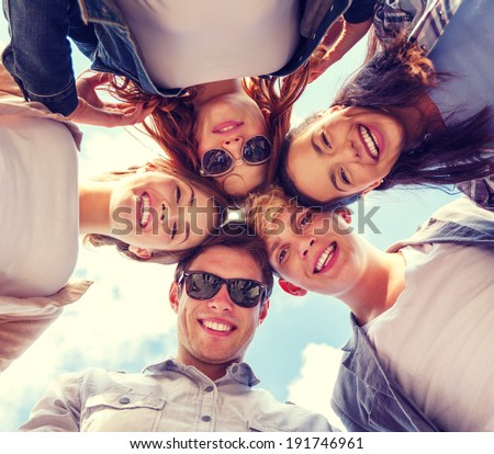 summer holidays and teenage concept - group of teenagers looking down Royalty-Free Stock Photo #191746961