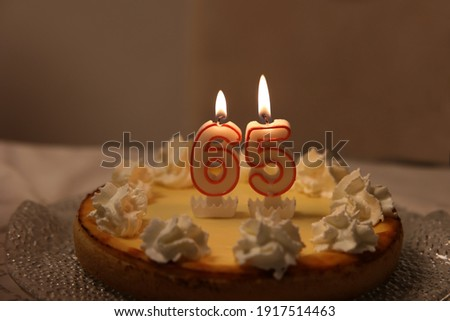 An image of a birthday cake with candle - 65.