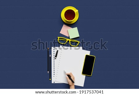 Office, business utensils on a blue table  table , telephone, a cup of tea, pencils, a notebook, glasses, a plant in a pot. Hand signing the document. 3d illustration. Render.