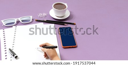 Office, business utensils on a purple table , telephone, a cup of tea, pencils, a notebook, glasses, a plant in a pot. Hand signing the document. 3d illustration. Render.