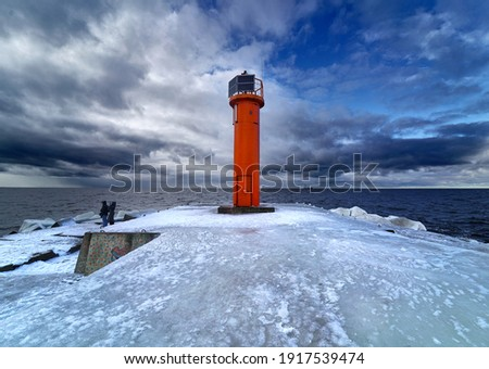 Winter on shore of the Baltic Sea. Lighthouse in ice Royalty-Free Stock Photo #1917539474