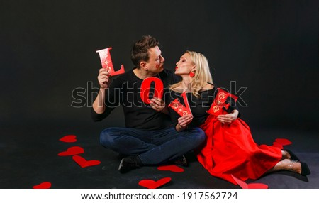 Family keeps the word LOVE Valentine, happiness, on the floor hearts romance romance. inspiration is art. emotion forever, joy in a red dress girl, barefoot symbol, board valentines valentine romantic