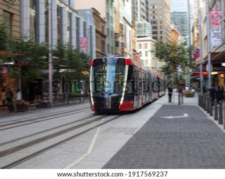 Tram moving through George St in Sydney NSW Australia Royalty-Free Stock Photo #1917569237