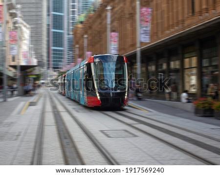 Tram moving through George St in Sydney NSW Australia Royalty-Free Stock Photo #1917569240