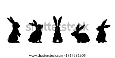 Silhouettes of easter bunnies isolated on a white background. Set of different rabbits silhouettes for design use. Royalty-Free Stock Photo #1917591605