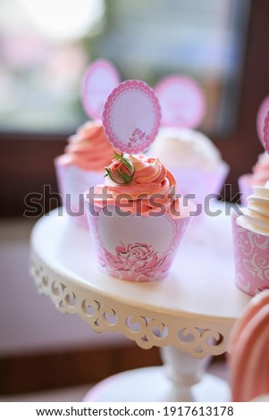 Delicious wedding reception candy bar, dessert table. Pink Sweet table with roses flowers, cupcakes for birthday party. Festive decor in restaurant. Anniversary dating celebration. Delicious buffet Royalty-Free Stock Photo #1917613178