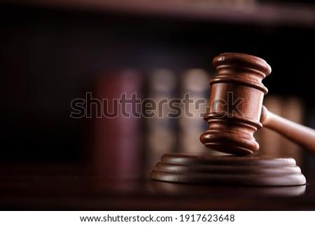 Judges gavel on wooden desk. Law firm concept.