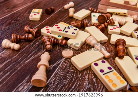 A variety of board game pieces. A background miscellaneous board game pieces. Royalty-Free Stock Photo #1917623996