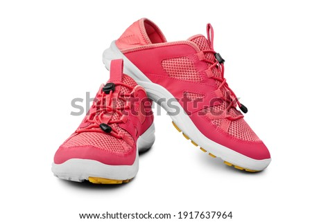 Red sneakers white background isolated close up front side view, pink sport sneaker shoes, pair running gumshoes, two fabric fitness boots, athletic leather footwear, fashion walking textile footgear Royalty-Free Stock Photo #1917637964