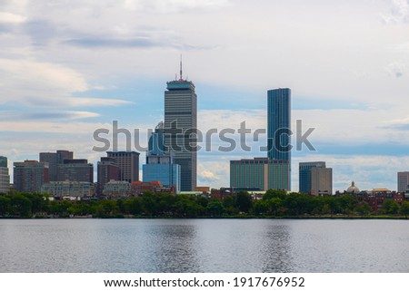 Boston Back Bay modern city skyline including Prudential Tower and Four Seasons Hotel at One Dalton Street viewed across Charles River in Cambridge, Boston, Massachusetts MA, USA.