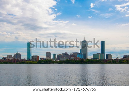 Boston Back Bay modern city skyline including John Hancock Tower, Prudential Tower and Four Seasons Hotel at One Dalton Street viewed across Charles River in Cambridge, Boston, Massachusetts MA, USA.