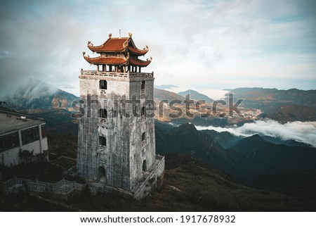 The Stone Pagoda and pavilion in Temple on Fansipan mountain peak the highest mountain in Indochina. Royalty-Free Stock Photo #1917678932