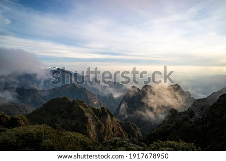 Fansipan mountain the highest mountain in the Indochinese Peninsula comprising Vietnam, Laos, and Cambodia, hence its nickname Roof of Indochina . Lao Cai, Vietnam. Royalty-Free Stock Photo #1917678950