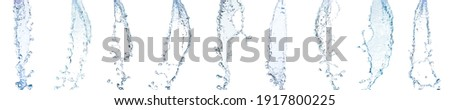 collection of pouring clean water from a height or a beautiful splash of blue water Isolated on white background Royalty-Free Stock Photo #1917800225