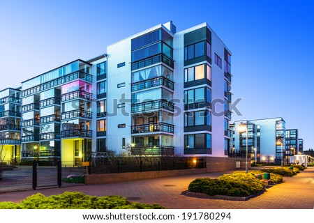 House building and city construction concept: evening outdoor urban view of modern real estate homes #191780294