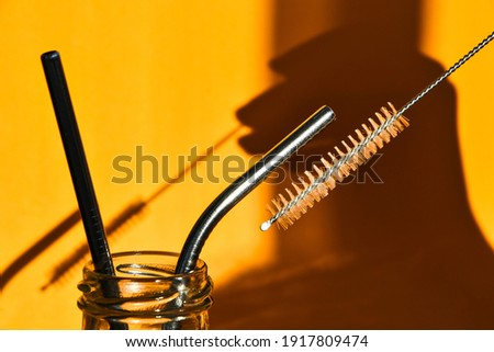 Reusable Metal Straws on yellow background - Stainless Steel, Eco-Friendly Drinking Straw Set. Zero waste. Plastic free. Stainless Steel Metal Straws, Reusable Comfortable Rounded tip Drinking Straws Royalty-Free Stock Photo #1917809474