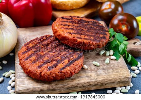Tasty grilled burger made with vegetarian plant based imitation minced soya beans meat Royalty-Free Stock Photo #1917845000