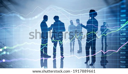 Double exposure of working business people at international investment institution, banking. Financial charts and business analytics. New York on background. Royalty-Free Stock Photo #1917889661