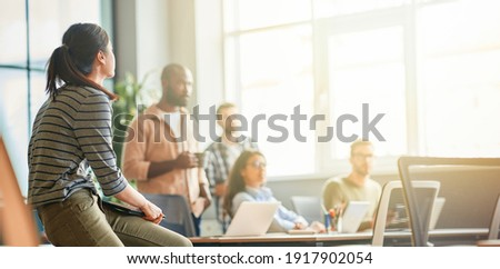 Cultural mix of young people working in a company Royalty-Free Stock Photo #1917902054