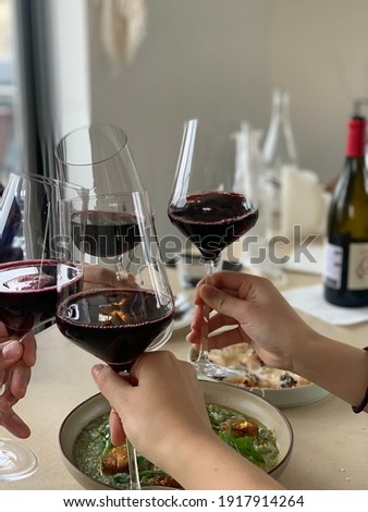 The wine glasses are bumping into each other.  I am so happy when I eat delicious food with my friends.