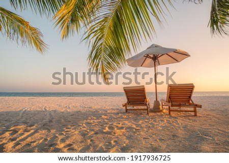 Beautiful beach. Chairs on the sandy beach near the sea. Summer holiday and vacation concept for tourism. Inspirational tropical landscape. Tranquil scenery, relaxing beach, tropical landscape design Royalty-Free Stock Photo #1917936725
