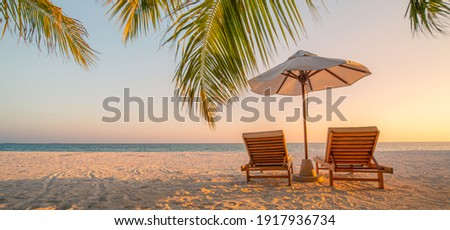 Beautiful beach. Chairs on the sandy beach near the sea. Summer holiday and vacation concept for tourism. Inspirational tropical landscape. Tranquil scenery, relaxing beach, tropical landscape design Royalty-Free Stock Photo #1917936734