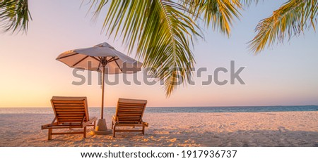 Beautiful beach. Chairs on the sandy beach near the sea. Summer holiday and vacation concept for tourism. Inspirational tropical landscape. Tranquil scenery, relaxing beach, tropical landscape design Royalty-Free Stock Photo #1917936737