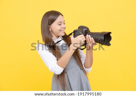 kid use digital camera. happy child photographing. school of photography. hobby or future career. photographer beginner with modern camera. making video. childhood. teen girl taking photo.