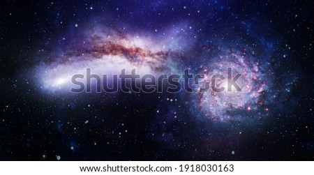 Giant glowing nebula. Space background with red nebula and stars. Elements of this image furnished by NASA. Royalty-Free Stock Photo #1918030163
