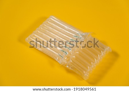 Closeup view color stock photography of empty wrapping protective plastic air package for shipping safely fragile goods